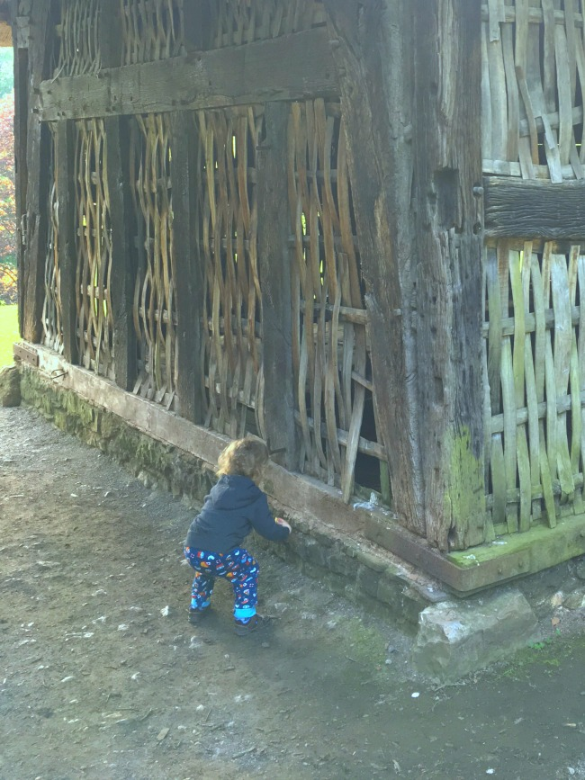old-barn-with-toddler-crouched-down-St-Fagans-Castle-and-gardens
