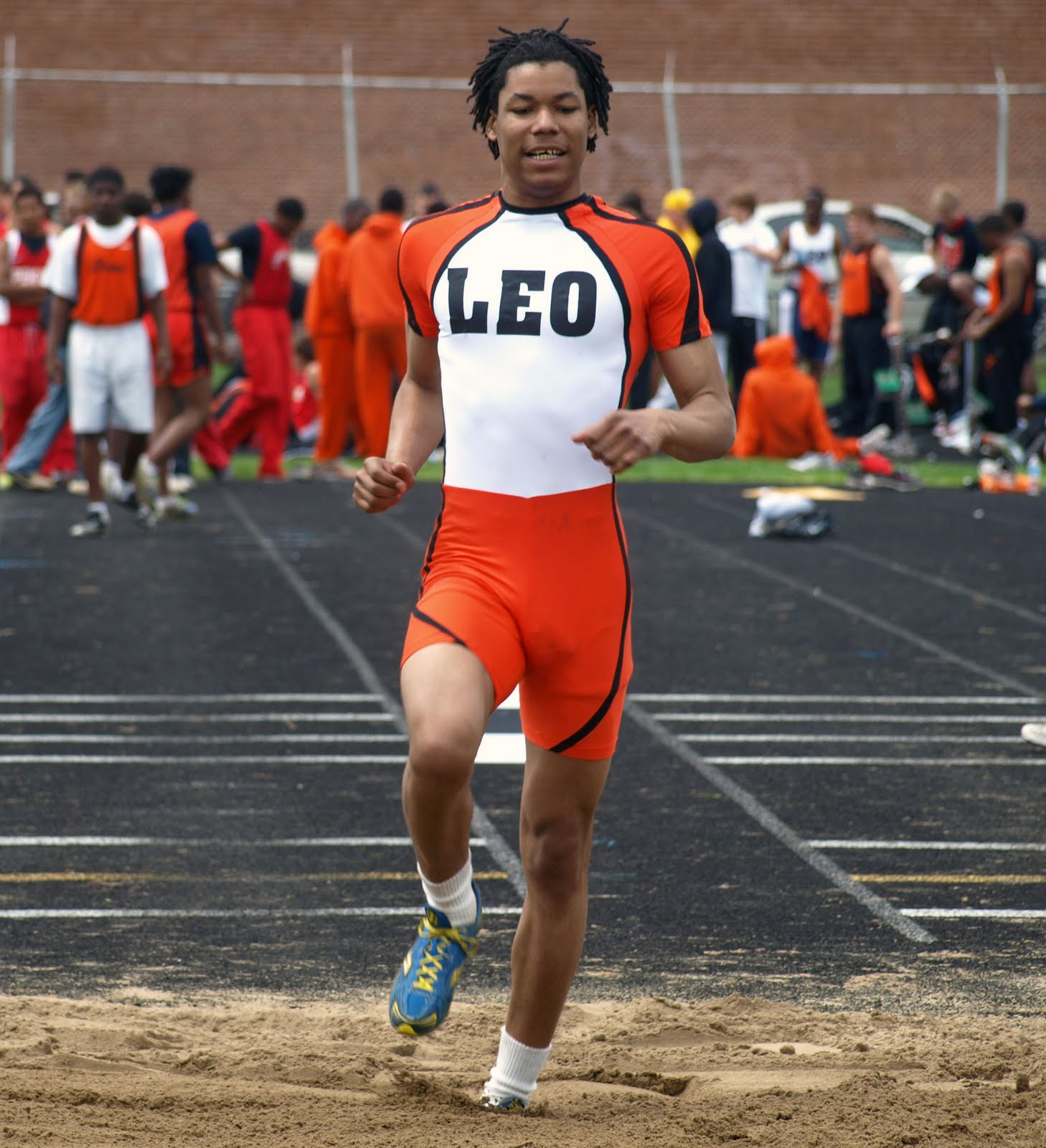 With Both Hands: Leo High School Track Team ( The School