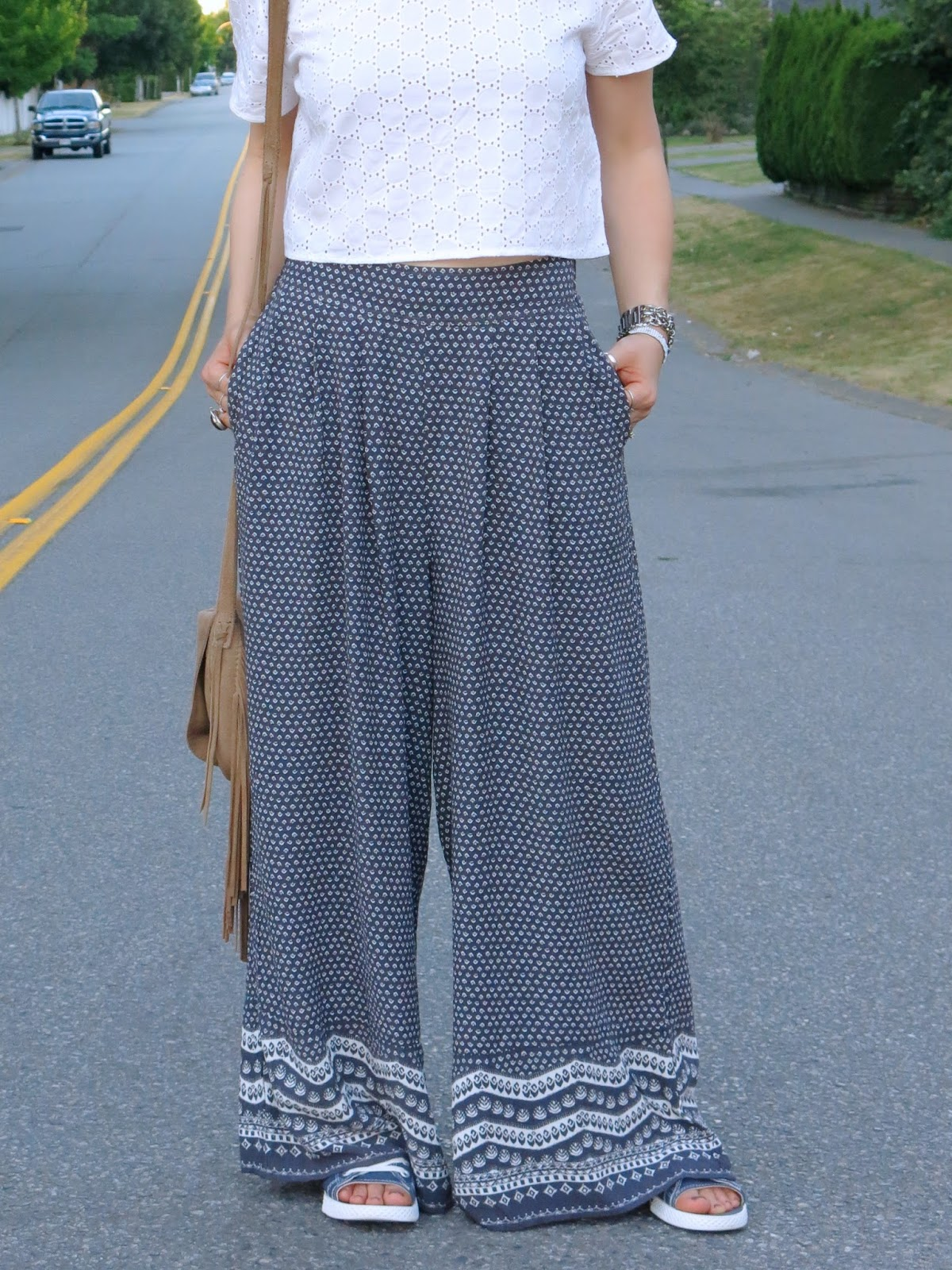 styling palazzo pants with a white eyelet crop top