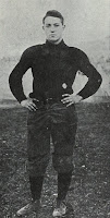 photograph of Sturgis 'Spuddy' Pishon in his football uniform, hands on hips.
