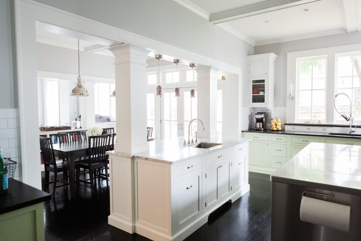 Modern farmhouse kitchen and breakfast area with black floors on Hello Lovely Studio