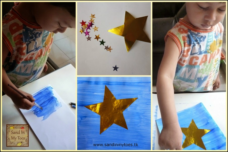 My toddler making a shiny star card for Dad
