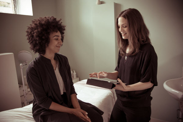 Kathryn Sawers, of Vancouver-based skincare and facial treatment Collective Skincare, offers a client a consultation.