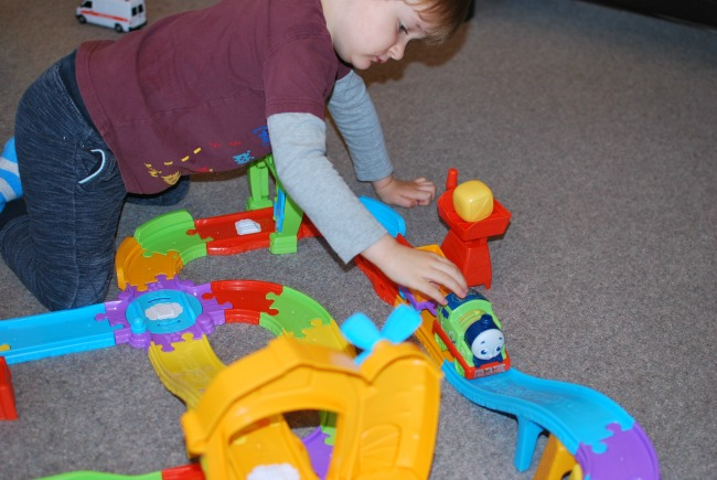 toddler-playing-with-fisher-price-my-first-thomas-&-friends-railway-pals
