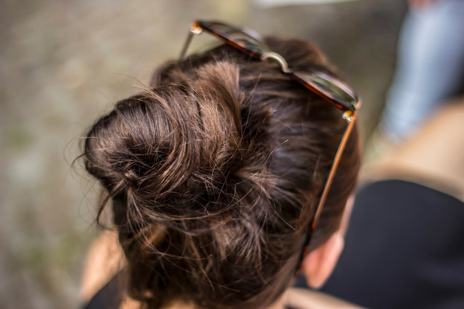 woman with hair in a bun - 5 hair accessories that every woman must have - motherdistracted.co.uk