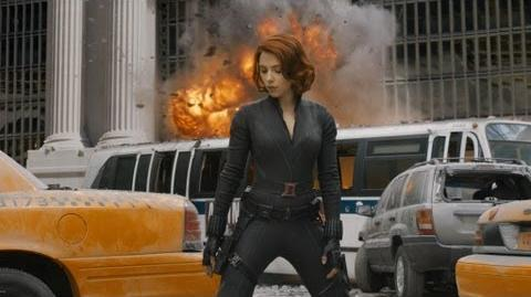 Scarlett Johansson with her legs spread wide in her black catsuit as Black Widow in The Avengers 2012 movieloversreviews.filminspector.com