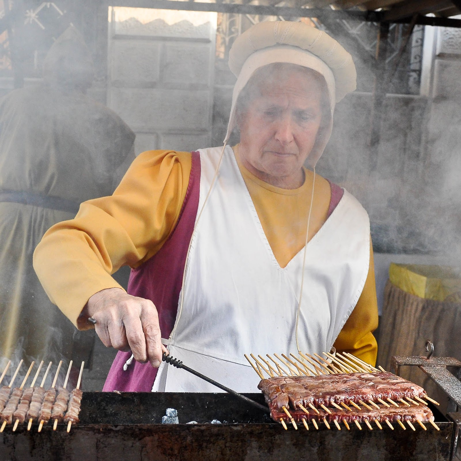 Roasting traditional Italian lamb shish kebabs on coals, Thiene, Veneto, Italy