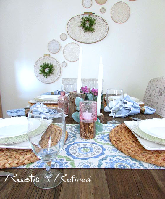 Winter or Spring Tablescape for the home using white dishes, pinks and soft blues.