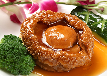 Abalone, (鲍鱼, Bào yú) sounds like 保余 (Bǎo yú), meaning guaranteed surplus.