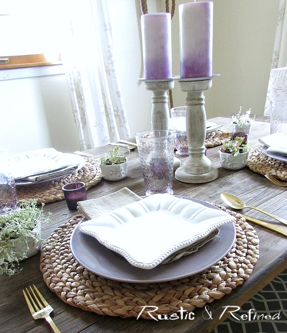 Table top setting with purple and white dishes