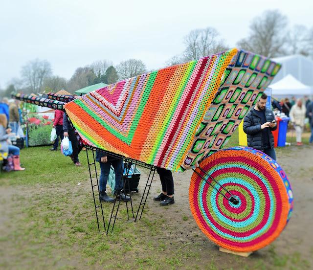 Large crocheted wheelbarrow.