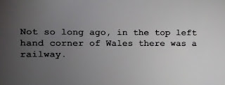 "Typed text: ""Not so long ago, in the top left hand corner of Wales, there was a railway."""