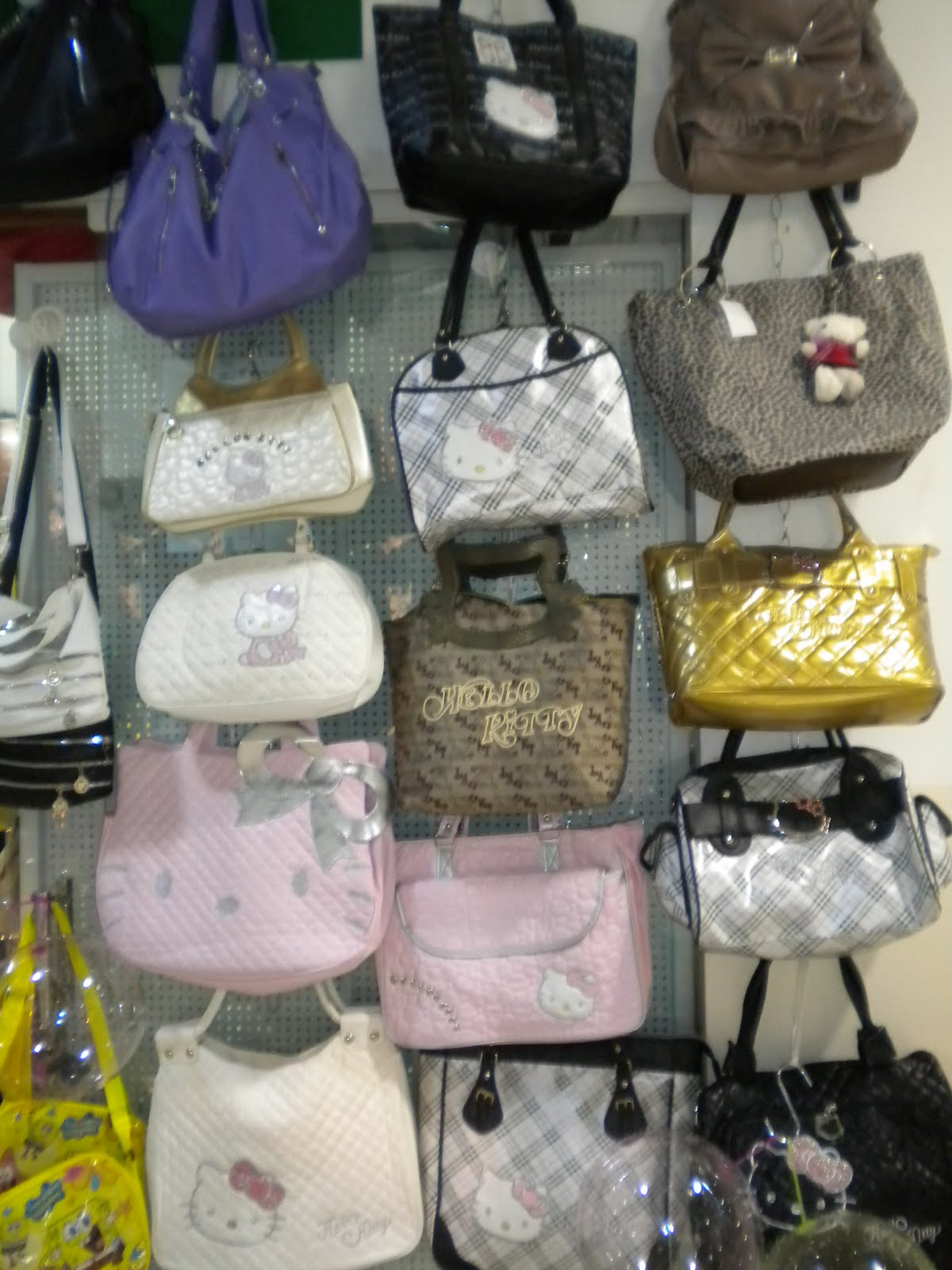 swing chair dragon mart leg sliders for carpet here today dubai tomorrow window washer all of these are hello kitty purses this one is you dara