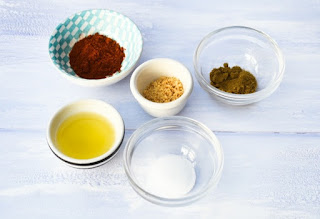 olive oil and spice in pinch bowls
