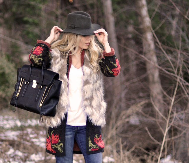woodsy outfit in the woods, faux fur vest