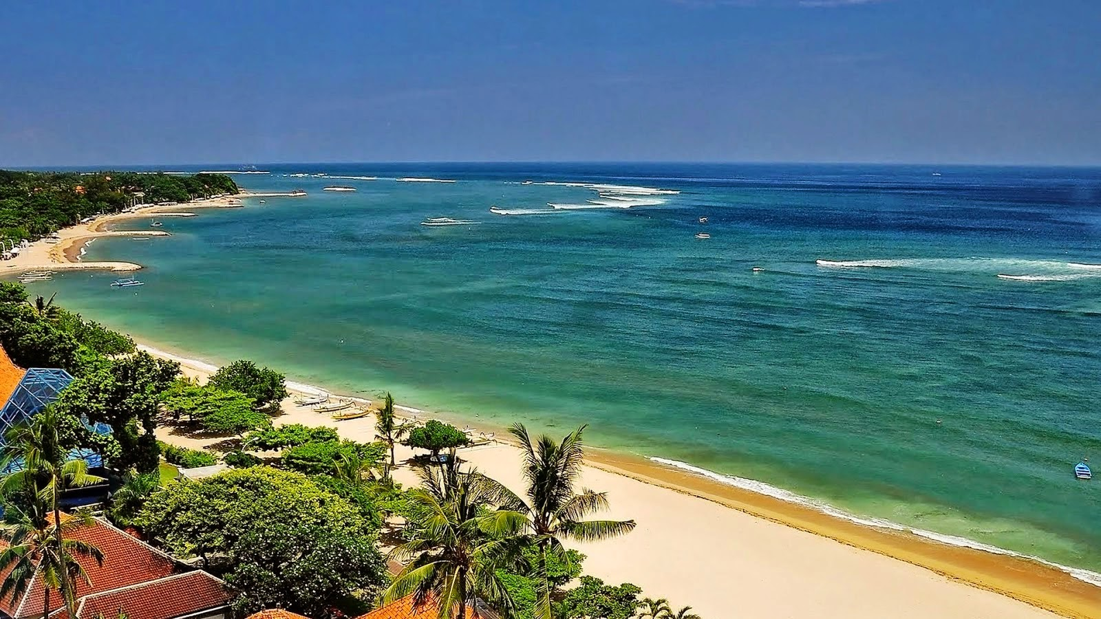 kuta beach is a tourist spot in bali the most famous and visited by tourists because of its location close to airport beautiful beaches suitable