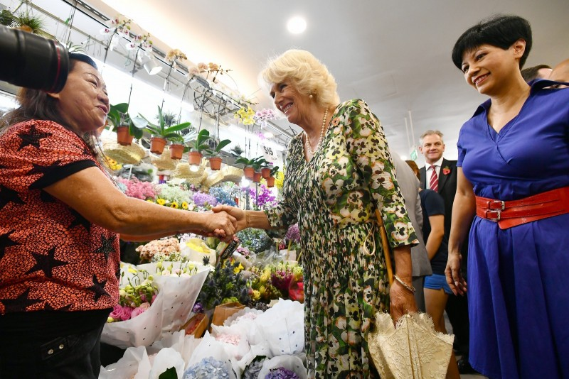 Duchess Camilla with MP Indranee Rajah at Tiong Bahru Market, interacting with the aunties at the flower shop.