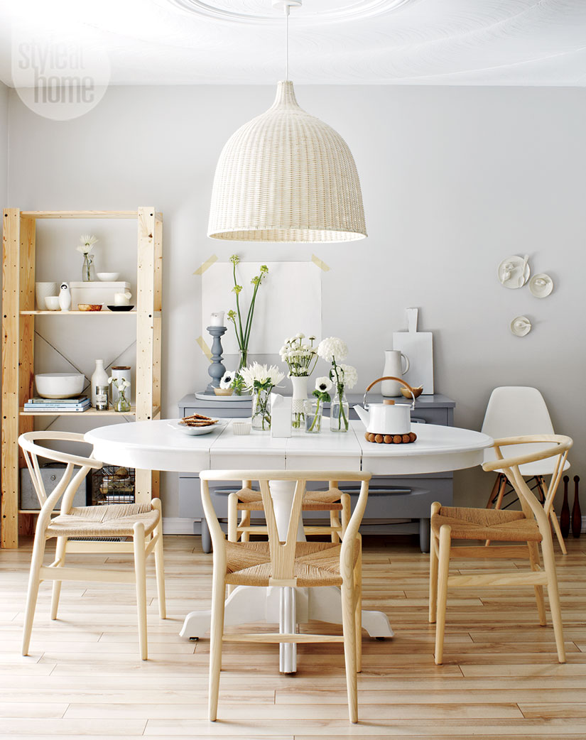 white and blue dining room decor with light wood floros and chairs
