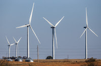 Five wind towers on a farm (Credit: Nati Harnik, AP) Click to Enlarge.