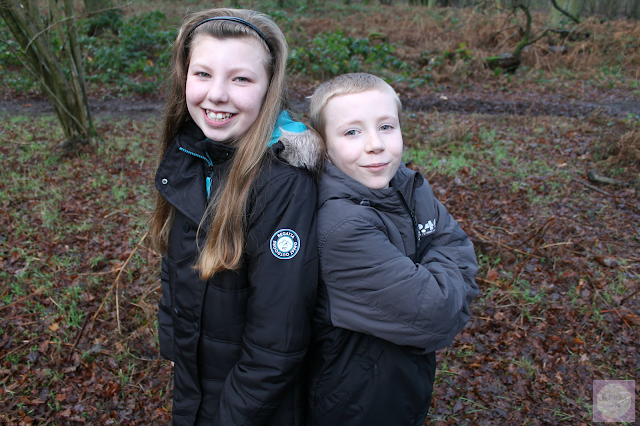 Brother and sister in woodland setting