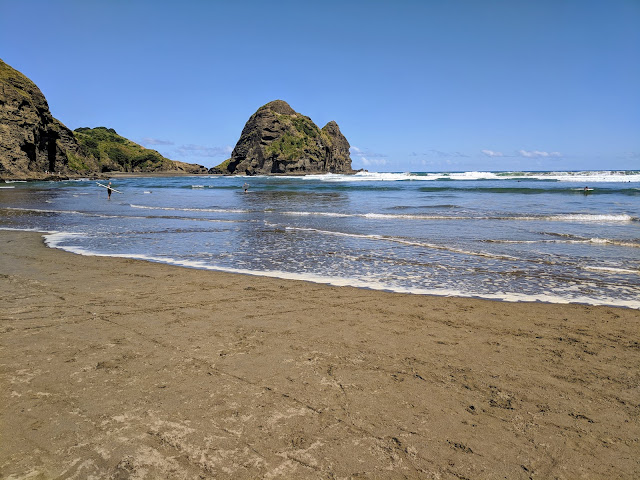 Tide coming in at Piha Beach near Auckland New Zealand