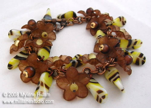 I love the bumble bee look of these striped beads... it's like they're bees visiting the lucite flowers!