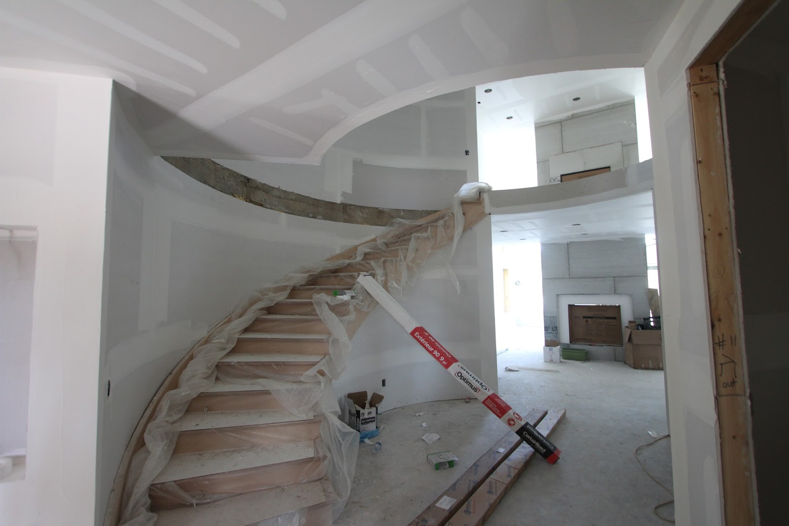 The Stairs Are Still Well Protected From Damage And As Soon As The Drywall  Is Completed, The Woodworking Can Begin.