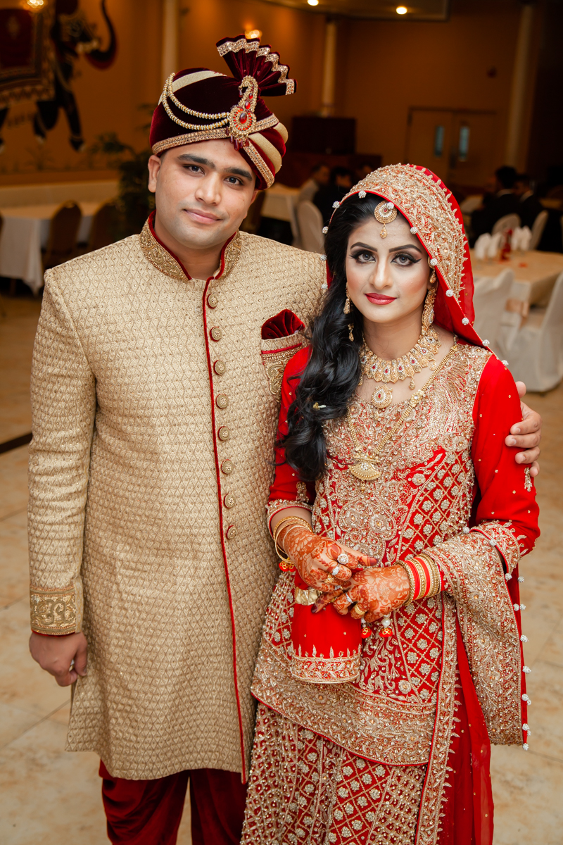 Bride and Groom colorfully dressed