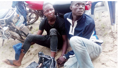 Delta State police arrest two teenage robbers found with guns