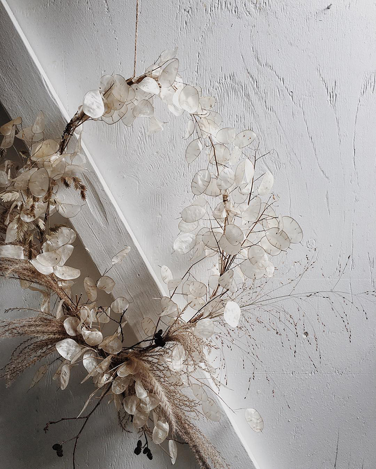 Natural white wreath with dried plants for simple Christmas decoration by joeybutta