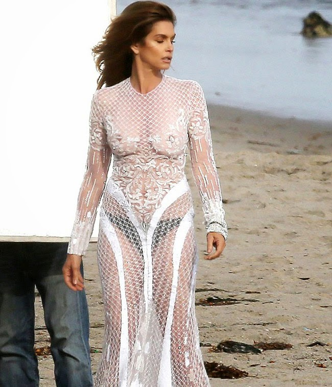 Cindy Crawford goes braless in a white see-through dress
