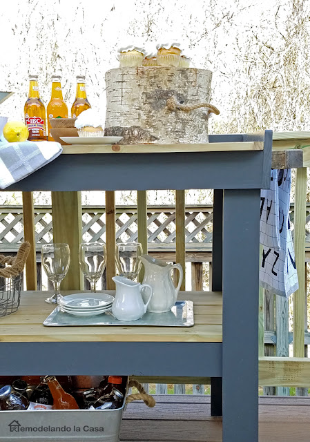 floating deck with grey serving cart - entertainment station