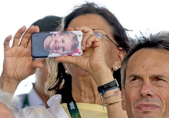 Queen Silvia take a photo with here phone, which features a picture of her granddaughter Princess Estelle