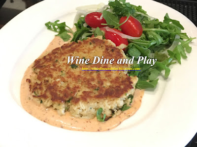 The crab cake bar happy hour dish with remoulade and arugula at RumFish Grill in St. Pete Beach, Florida