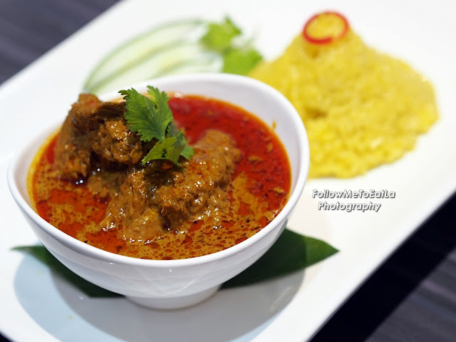 Nasi Kunyit with Curry Chicken RM 15.90