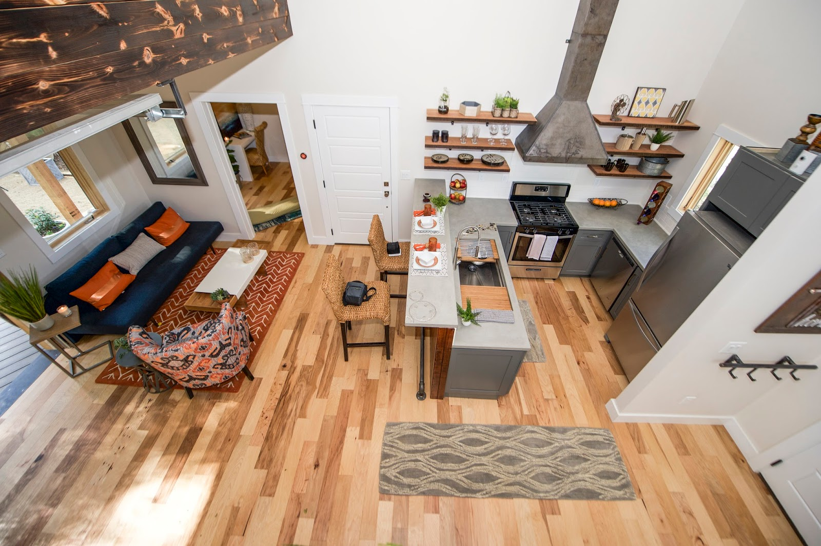 micro home. The kitchen features a concrete countertop by Set in Stone  custom steel stove top open shelving made from reclaimed beam wood and gallery workstation Little Living Blog Urban Micro Home