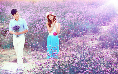 love-couple-wandering-in-the-flower-farm