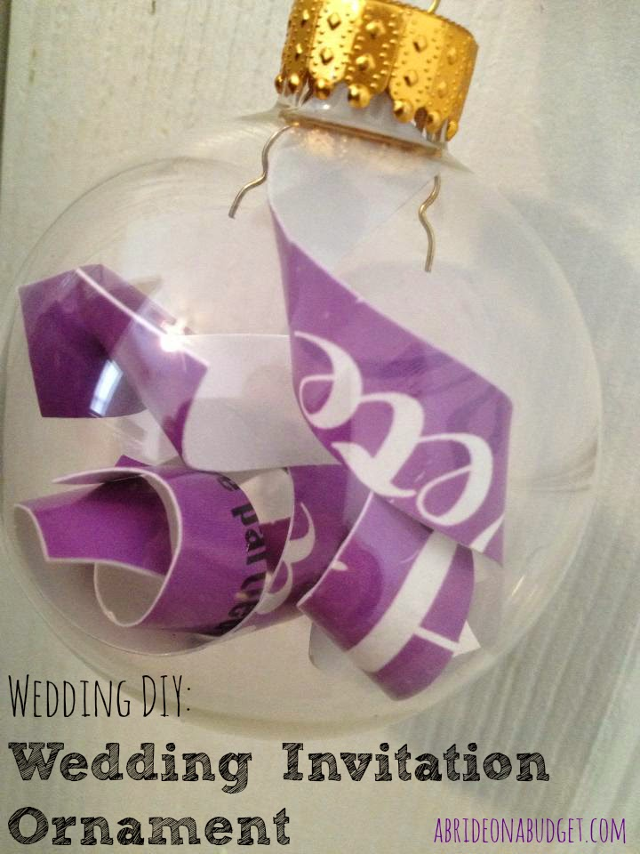 Looking for something festive to do with your wedding invitation? Turn it into a DIY Wedding Invitation Ornament with this tutorial on www.abrideonabudget.com.