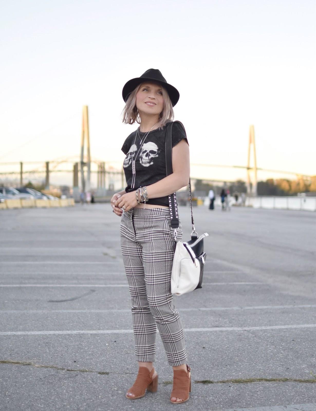 Monika Faulkner outfit inspiration - styling houndstooth trousers with a skull tee, open-toe booties, and a felt fedora