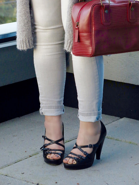 long cardigan, grey skinny jeans, strappy heels, and Elvis & Kresse bag