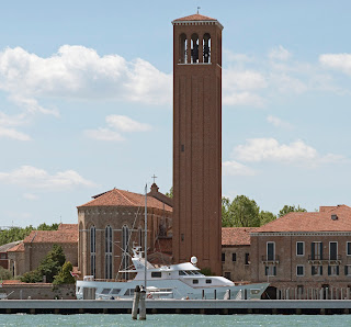 The church of Sant'Elena with its tall belltower, seen from the lagoon of Venice
