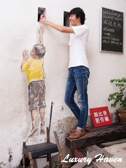 penang george town street arts boy on chair mural