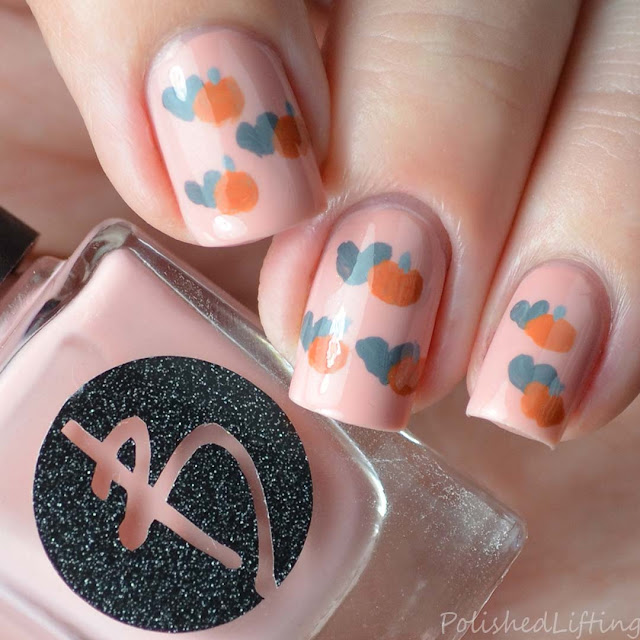hand painted pumpkin and heart nail art