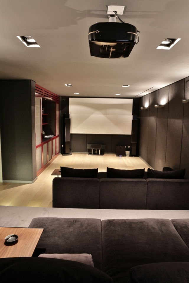 Home theater room in The Memory House by A-Cero Architects