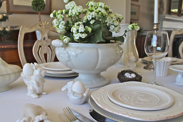 neutral easter tablescape white silver grey white flowers centerpiece
