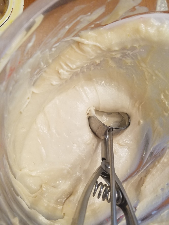 this is cake batter in a bowl ready to pour over apple pie filling