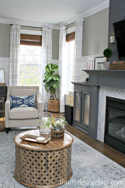 Gray fireplace in family room with built in storage