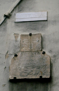 Plaques on the Via San Remigio in  Florence mark the level of both floods