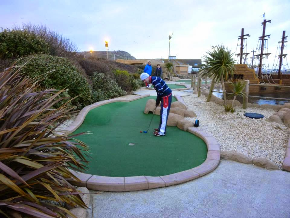 Michael Smith playing hole 14 of the Pirate Golf course at Hastings Adventure Golf