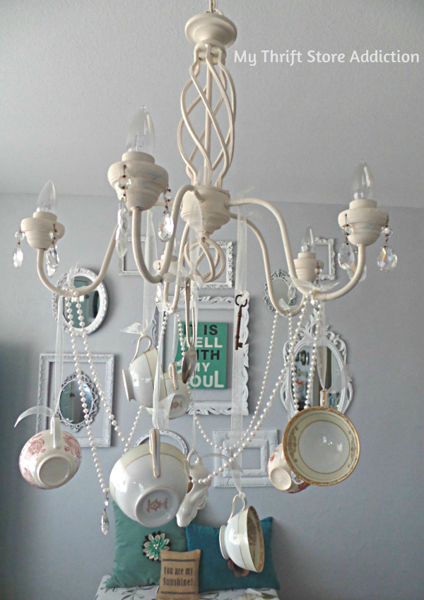 DIY Whimsical Teacup Chandelier mythriftstoreaddiction.blogspot.com Create a unique chandelier using ribbon and teacups!
